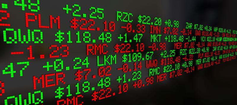 Grafik mit Börsentickersymbolen und Daten in rot und grün.