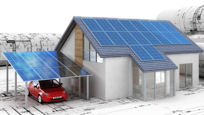 Modell eines Einfamilienhauses mit Solardach und SOlar-Carport auf Bauplänen.