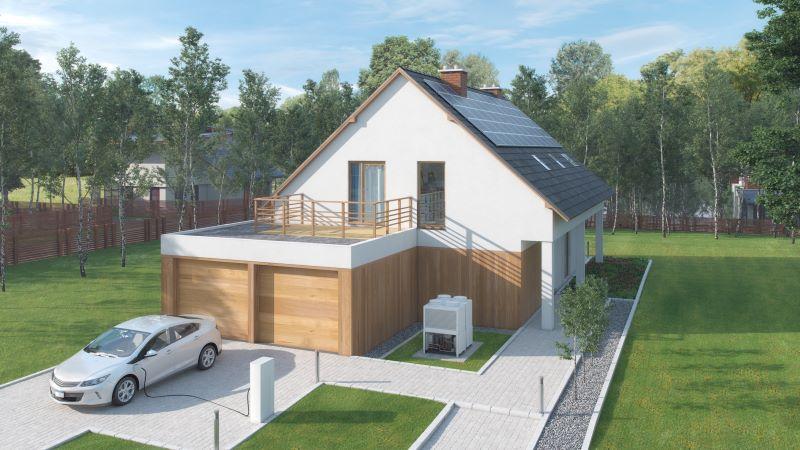 Ein Elektroauto steht vore einem Haus mit PV-Anlage auf dem Dach.