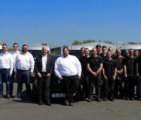 Zu sehen sind die Mitarbeitenden der Trierer Photovoltaik-Firma Schoenergie