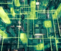 Symbolbild Hochhauslandschaft aus Vogelperspektive mit symbolischem Energie- und Datentransfer