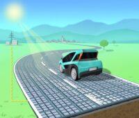 Das Bild zeigt eine mit Solarmodulen belegte Solarstraße mit einem kleinen Elektroauto.