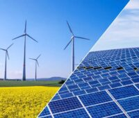 Zu sehen ist eine Fotomontage aus Photovoltaik und Windenergie als Symbol für die Verbesserungen, die das vom Bundestag beschlossene Energie- und Klimapaket bietet.